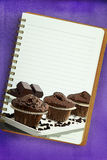 Recipe book. Muffins painting on blank notebook page Stock Photos