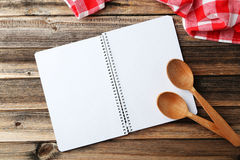 Recipe book. Open blank recipe book on brown wooden background Stock Photo