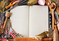 Recipe book. Open recipe book surrounded of food ingredients and kitchen utensils Stock Photo