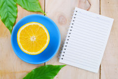 Recipe book with orange fruit Stock Image