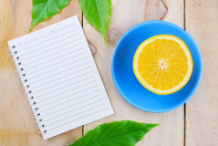 Recipe book with orange fruit stock photography