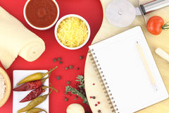 Recipe book for pizza. On the table Stock Images