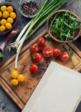 Recipe book surrounded of colorful fresh vegetables Stock Images