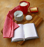 Recipe book on the table in the kitchen Stock Photography