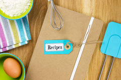 Recipe book with tea towel, ingredients and kitchen utensils Royalty Free Stock Image