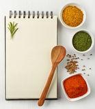 Recipe book. And various spices on white wooden background Stock Photos