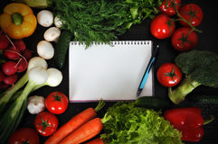 Recipe book. With vegetables on wooden table Stock Image