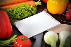 Recipe book with vegetables Royalty Free Stock Image