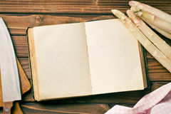 Recipe book and white asparagus Royalty Free Stock Photos