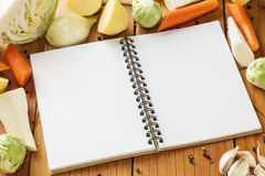 Recipe Book. Winter vegetables and notebook for your recipe Royalty Free Stock Photos