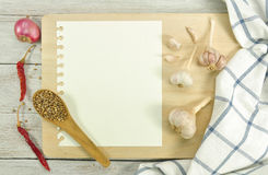 Recipe book. On wood table Royalty Free Stock Photos