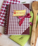 Recipe book on wooden table Stock Image