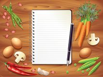 Recipe book on wooden table, food ingredients Stock Photos