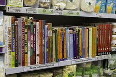 Recipe books on shelf Stock Image