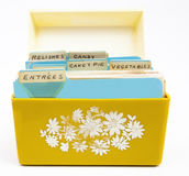 Recipe Box. Front view of old yellow and orange recipe box with handwritten recipe tabs Stock Photography