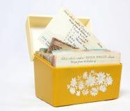 Recipe Box. Vintage yellow and orange open plastic recipe box with handwritten recipes Royalty Free Stock Photo