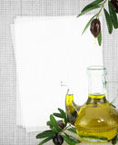 Recipe card. Bottle of olive oil on fabric texture Stock Image