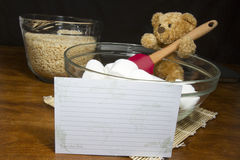 Recipe Card with Baking Bear Making Cereal Treats. Teddy bear cook making puffed rice cereal cookie treats with recipe card Royalty Free Stock Image
