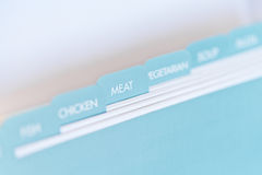 Recipe card dividers, meat. Named tabs on a recipe card box with meat in focus Royalty Free Stock Image