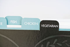 Recipe card dividers, vegetarian. Named tabs on a recipe card box with vegetarian in focus Stock Photo