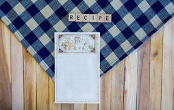 Recipe Card on Navy Check Napkin and Wood Planks. Recipe card on navy check napkin and wood plank background with the word recipe Royalty Free Stock Photo