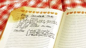 Recipe in cookbook. Written recipe of easy chocolate cake in cookbook Stock Images