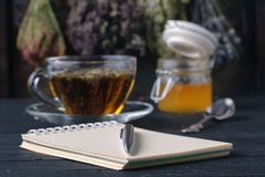 Recipe of healing herbal tea with open notebook Royalty Free Stock Images