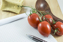Recipe note card. Blank note card for recipe on wood table with tomatoes and spoon Royalty Free Stock Image