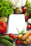 Recipe notebook and fresh vegetable Stock Images