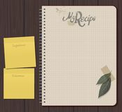 Recipe notebook with hand drawn text. Olive and laurel leaves with adhesive tape. Yellow sticky notes. Blank space Royalty Free Stock Images