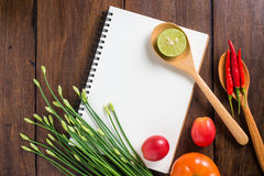Recipe notebook, rice, Red chilli, garlic and lemon on wooden ba Royalty Free Stock Images