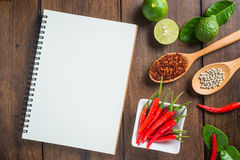 Recipe notebook, rice, Red chilli, garlic and lemon on wooden ba Royalty Free Stock Photos