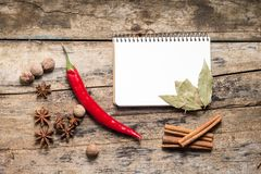 Recipe Notepad with Spices on Table Stock Photos