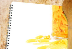 Recipe pasta book. Blank recipe book on grunge background with pasta Stock Photography