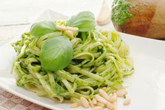 Recipe with pasta with pesto sauce Stock Photography