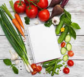 Recipe planning concept. With raw vegetables and ingredients Stock Photography