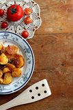 Recipe for potatoes with tomatoes Royalty Free Stock Image