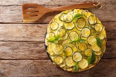 The recipe for salty scarpaccia is typical of the Tuscan. Open z. Ucchini tart with flowers closeup on the table. Horizontal top view from above royalty free stock images