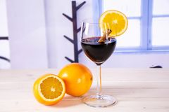 Recipe step by step hot red mulled wine with blue window royalty free stock image