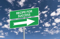 Recipe for success. Road sign with a directional arrow, blue sky and cloudscape background Royalty Free Stock Image