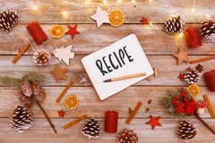 Recipe text in note pad on christmas flat lay. Table with image photo frame and light chain shining, including copy space Royalty Free Stock Image