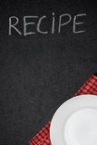 Recipe Title Is Written In Chalk On A Blackboard And Empty Plate Stock Photo