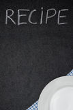 Recipe title is written in chalk on a blackboard and plate on na Royalty Free Stock Photo