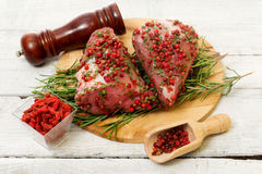 Recipe witk pork fillet, pink pepper and goji berries Royalty Free Stock Photography