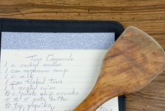 Recipe And Wooden Spoon Royalty Free Stock Photos