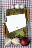 Recipes. Paper for the recipes on a wooden board Royalty Free Stock Photo