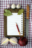 Recipes. Paper for the recipes and pencil on a wooden board Royalty Free Stock Photo