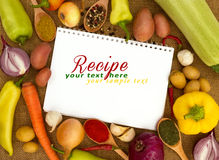 Recipes book. With fresh vegetables stock photos