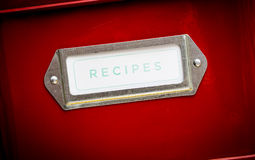 Recipes storage tin. Red recipes storage tin with label Royalty Free Stock Images