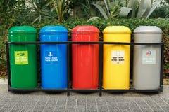 Recipientes de lixo coloridos para a separação do lixo Fotos de Stock Royalty Free